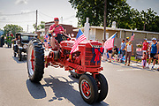 03 JULY 2021 - NORWALK, IOWA: Antique vehicles drive through town during the 4th of July parade in Norwalk, Iowa. Last year's parade was cancelled because of the COVID-19 pandemic. Norwalk is an agricultural community south of Des Moines. In recent years, Norwalk has become a suburb of Des Moines.       PHOTO BY JACK KURTZ