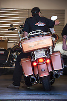 """Trevor Rymer checks in the """"Geezer Glide"""" for service at the Laconia Harley Davidson on Tuesday morning.  (Karen Bobotas/for the Laconia Daily Sun)"""