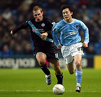 Photo. Aidan Ellis.<br /> Manchester City v Leicester City.<br /> FA Cup Rd3.<br /> 03/01/04.<br /> Manchester's Jihai Sun and Leicester's James Scowcroft