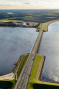 Nederland, Flevoland, Noordoostpolder, 28-02-2016; Ketelbrug met rijksweg A6, gezien naar Kamperhoek in oostelijk Flevoland, vanuit  naar Zwolsehoek Noordoostpolder. Ketelmeer en rechts IJsselmeer. Het beweegbare deel is een basculebrug.<br /> One of the largest bridges in Holland, connecting two of the newest polders.<br /> <br /> luchtfoto (toeslag op standard tarieven);<br /> aerial photo (additional fee required);<br /> copyright foto/photo Siebe Swart