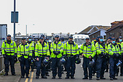 Kent Police form lines to strategise and disperse anti-migrant protesters who demonstrate against immigration and the increase in journeys made by refugees crossing the English Channel in dinghies to the UK on Saturday, Sept 5, 2020 - in Dover, England. The demonstrators blocked the main dual carriageway into the port after an earlier demonstration by migrant supporters in the town's Market Square. (VXP Photo/ Vudi Xhymshiti)