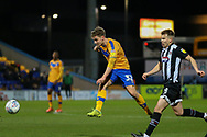 Mansfield Town forward Danny Rose (32) shoots at goal  during the EFL Sky Bet League 2 match between Mansfield Town and Grimsby Town FC at the One Call Stadium, Mansfield, England on 4 January 2020.