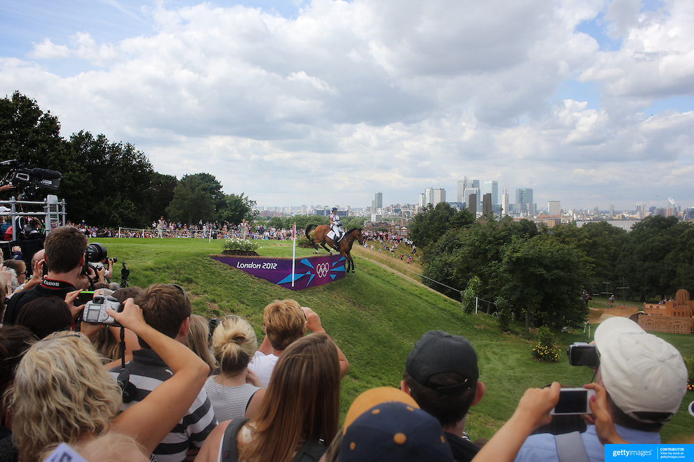 Mary King, Great Britain, riding Imperial Cavalier navigates a difficult jump during the Cross Country event in the Eventing competition in front of massive crowds at Greenwich Park  during the London 2012 Olympic games. London. UK. 29th July 2012. Photo Tim Clayton