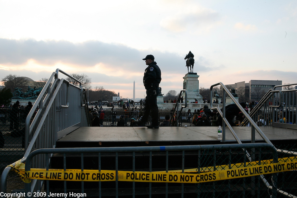 Police secure the zone around the capitol building on the eve of Barack Obama's inauguration.