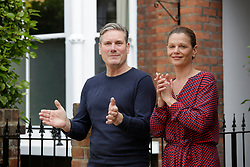 © Licensed to London News Pictures. 05/07/2020. London, UK. As part of the NHS birthday celebrations, Leader of the Labour Party, Sir Keir Starmer with his wife Victoria outside their home in north London join in the pause for applause to salute the NHS 72nd birthday. Photo credit: Marcin Nowak/LNP
