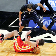 ORLANDO, FL - MARCH 03: Michael Carter-Williams #7 of the Orlando Magic leaps over a falling Danilo Gallinari #8 of the Atlanta Hawks during the second half at Amway Center on March 3, 2021 in Orlando, Florida. NOTE TO USER: User expressly acknowledges and agrees that, by downloading and or using this photograph, User is consenting to the terms and conditions of the Getty Images License Agreement. (Photo by Alex Menendez/Getty Images)*** Local Caption *** Michael Carter-Williams; Danilo Gallinari