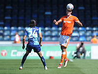 Blackpool's Ben Heneghan heads the ball despite the attentions of Wycombe Wanderers' Randell Williams<br /> <br /> Photographer Kevin Barnes/CameraSport<br /> <br /> The EFL Sky Bet League One - Wycombe Wanderers v Blackpool - Saturday 4th August 2018 - Adams Park - Wycombe<br /> <br /> World Copyright © 2018 CameraSport. All rights reserved. 43 Linden Ave. Countesthorpe. Leicester. England. LE8 5PG - Tel: +44 (0) 116 277 4147 - admin@camerasport.com - www.camerasport.com