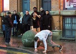© Licensed to London News Pictures . 01/01/2015 . Manchester , UK . A man falls to the ground as he is pushed by a woman away from bouncers outside Victoria's Lap Dancing Bar on Dantzic Street . Revellers usher in the New Year on a night out in Manchester City Centre .  Photo credit : Joel Goodman/LNP