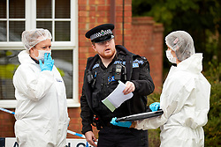 © Licensed to London News Pictures. 20/10/2019. Milton Keynes, UK. Police forensic officers investigate the scene in Archford Croft in Emerson Valley where two 17 year old boys were stabbed to death overnight. Two adult males where also injured. Thames Valley Police have begun a doyuble murder investigation but have yet to make any arrests.  Photo credit: Cliff Hide/LNP