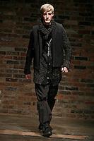 Dennis Johnson walks the runway wearing the Rag & Bone Fall 2009 Collection