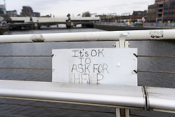 Sign on footbridge crossing River Clyde in Glasgow offering hope to public considering suicide, Scotland, UK