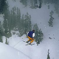 A skier jumps in powder snow at Mount Baker Ski Area, Washinton.