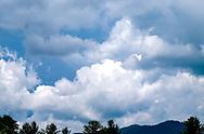 A Blue Ridge Sky full of dramatic white clouds in a blue sky.