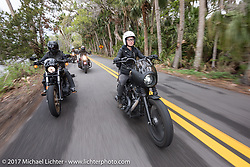 Anthony Paggio on a new 2017 Harley-Davidson alongside Iron Lilly Kristen Lassen on a 2014 Harley-Davidson Iron 883 Sportster as they ride through Tomoka State Park during Daytona Beach Bike Week. FL. USA. Tuesday, March 14, 2017. Photography ©2017 Michael Lichter.