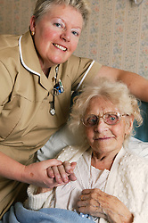 Portrait of Auxiliary Nurse with patient on female Orthopaedic Ward,