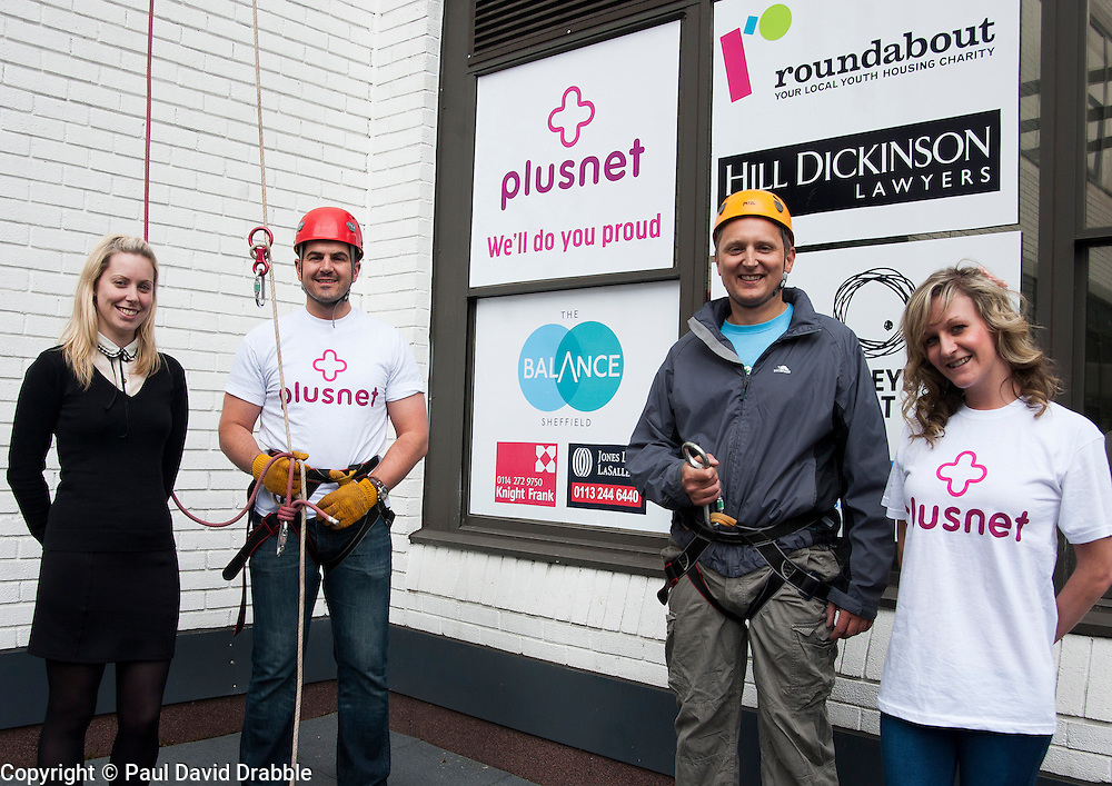 The Plusnet and Hill Dickinson Charity Abseil 111 feet down the Balance building in Sheffield to raise money for Roundabout and Saint Lukes Hospice on Wednesday Left to right Amy Casbolt from Roundabout, Mark Dundon of Plusnet, Giles Searby of Hill Dickinson and Chloe Snelson of Plusnet<br /> <br /> 11 June 2013<br /> Image © Paul David Drabble<br /> www.pauldaviddrabble.co.uk