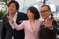 Actor Kwak Do-Won, actress Chun Woo Hee and actor Kunimura Jun at The Strangers (Goksung) film photo call at the 69th Cannes Film Festival Wednesday 18th May 2016, Cannes, France. Photography: Doreen Kennedy