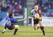 Twickenham, Surrey. UK., 12.01.2002, Quin's Mark Mapletoft, run's past a falling Cerith Rees, during the, Harlequins vs Bridgend, Heineken Cup Rugby match, played at the Stoop Memorial Ground, [Mandatory Credit: Peter Spurrier/Intersport Images],