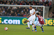 Ashley Williams of Swansea city (6) passes the ball past Carles Gil of Aston Villa. Barclays Premier league match, Swansea city v Aston Villa at the Liberty Stadium in Swansea, South Wales on Saturday 19th March 2016.<br /> pic by  Andrew Orchard, Andrew Orchard sports photography.
