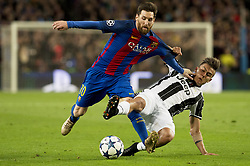 BARCELONA, April 20, 2017  Barcelona's Lionel Messi (L) vies with Juventus's Paulo Dybala during the UEFA Champions League quarter final second leg match between FC Barcelona and Juventus FC at the Camp Nou Stadium in Barcelona, Spain, April 19, 2017.  The match ended 0-0 tie. Juventus advanced to the semifinal with 3-0 on aggregate. (Credit Image: © Lino De Vallier/Xinhua via ZUMA Wire)