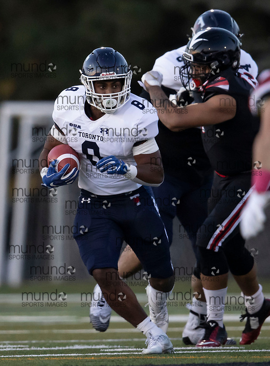 If you post on social media please tag @mundosportimages on Instagram or tag Mundo Sport Images on Facebook.<br /> <br /> (Ottawa, Canada---08 October 2021) Adam Williams (8 -- RB) of the University of Toronto Varsity Blues playing in the OUA football game between the Carleton University Ravens and the University of Toronto Varsity Blues at Carleton's Raven's perch stadium.  Photograph 2021 Copyright Sean Burges / Mundo Sport Images