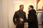 """Sean Pertwee and Johnny Lee Miller   """"Hold""""  exhibition of woirk by Natasha Law at Eleven.  January 12 2006. London. ONE TIME USE ONLY - DO NOT ARCHIVE  © Copyright Photograph by Dafydd Jones 66 Stockwell Park Rd. London SW9 0DA Tel 020 7733 0108 www.dafjones.com"""
