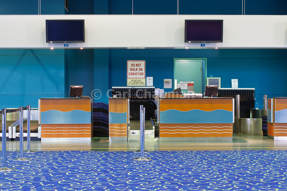Airport terminal check-in desk - Cairns International <br /> <br /> Editions:- Open Edition Print / Stock Image