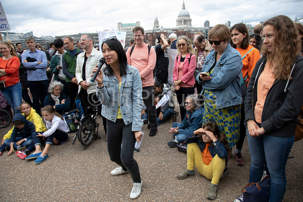 Tania Han, Climate Reality Leader, The Climate Reality Project UK speaks at the Rise For Climate Change event held outside Tate Modern in London, England, United Kingdom on September 8th 2018. Tens of thousands of people joined over 830 actions in 91 countries under the banner of Rise for Climate to demonstrate the urgency of the climate crisis. Communities around the world shined a spotlight on the increasing impacts they are experiencing and demanded local action to keep fossil fuels in the ground. There were hundreds of creative events and actions that challenged fossil fuels and called for a swift and just transition to 100% renewable energy for all. Event organizers emphasized community-led solutions, starting in places most impacted by pollution and climate change. Photographed for 350.org