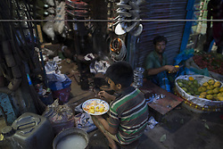 June 3, 2017 - Dhaka, Bangladesh - DHAKA, BANGLADESH - JUNE 03 : A child labor have a fast-breaking meal on the holy month of Ramadan on street in Dhaka, Bangladesh on June 03, 2017. (Credit Image: © Zakir Hossain Chowdhury via ZUMA Wire)