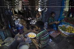 June 3, 2017 - Dhaka, Bangladesh - DHAKA, BANGLADESH - JUNE 03 : A child labor have a fast-breaking meal on the holy month of Ramadan on street in Dhaka, Bangladesh on June 03, 2017. (Credit Image: © Zakir Hossain Chowdhury via ZUMA Wire)