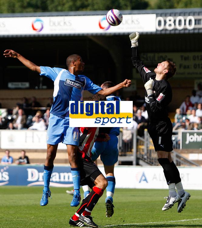 Photo: Richard Lane/Richard Lane Photography. Wycombe Wanderers v Brentford. Coca Cola Fotball League Two. Wycombe's Chris Zebroski (lt) challenges Bentford keeper, Ben Hamer.