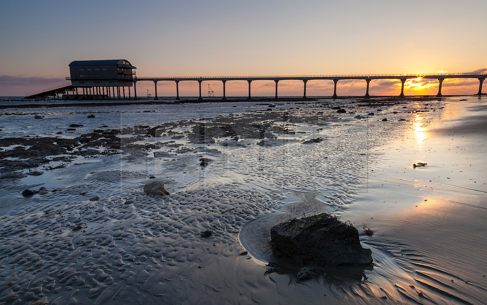 © Licensed to London News Pictures. 27/12/2014. Bembridge, Isle of Wight, UK. Sunrise at the RNLI lifeboat station at Lane End Beach on the Isle of Wight this morning, 27th December 2014. The South of England is expected to experience clear skies with a strong wind for the weekend. Photo credit : Rob Arnold/LNP