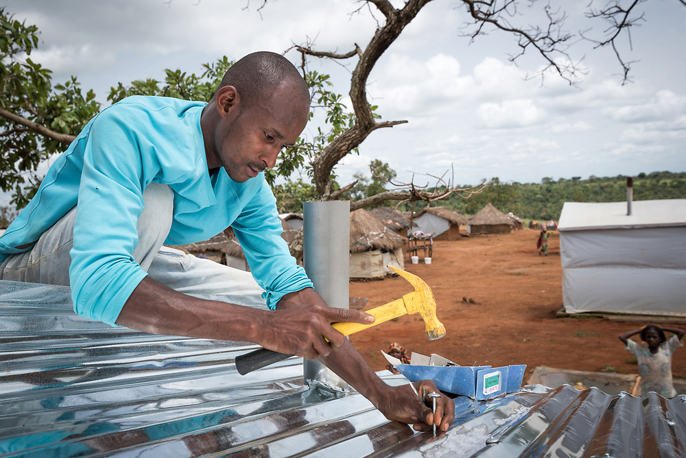 4 June 2019, Meiganga, Cameroon: CAR refugee Moussa Inoussa mounts a steel plate as roof of a latrine in the Ngam refugee camp. Supported by the Lutheran World Federation, the Ngam refugee camp, located in the Meiganga municipality, Adamaoua region of Cameroon, hosts 7,228 refugees from the Central African Republic, across 2,088 households.