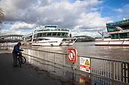 Cologne, Germany, February 4th. 2021, flood of the river Rhine, flooded landing stage, excursion boats.<br /> <br /> Koeln, Deutschland, 4. Februar 2021, Hochwasser des Rheins, uberfluteter Schiffsanleger, Ausflugsschiffe.
