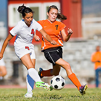 100212       Cable Hoover<br /> <br /> Grants Pirate Danielle Rael (4) squeezes a shot past Gallup Bengal Saryah Martinez (7) Tuesday at Gallup High School.