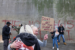 """© Licensed to London News Pictures. 08/11/2020. Manchester , UK. People dance in front of a concrete wall with """" The North is Not a Petri Dish """" written on it , in Piccadilly Gardens , during an anti lockdown protest in in Manchester City Centre  . Photo credit: Joel Goodman/LNP"""