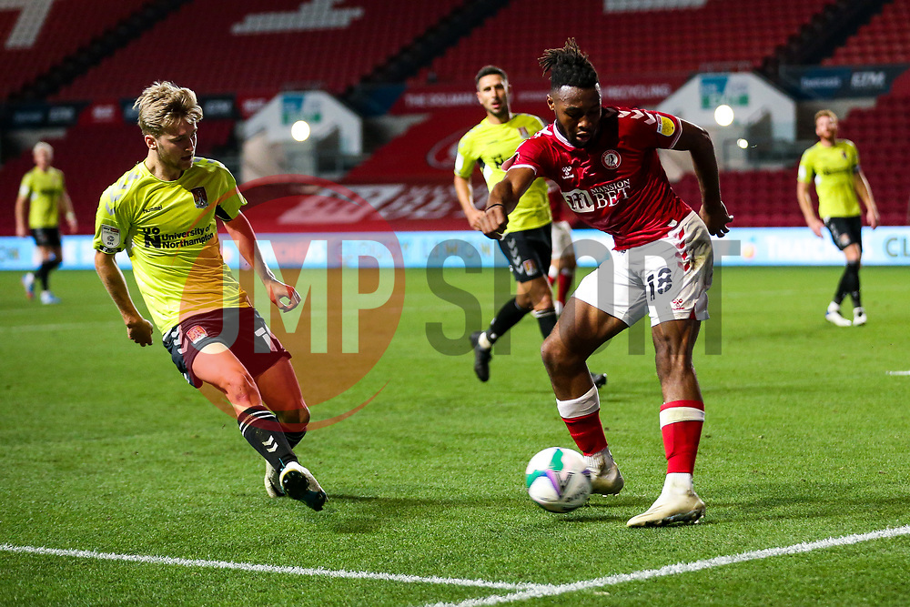 Antoine Semenyo of Bristol City is challenged by Morgan Roberts of Northampton Town - Rogan/JMP - 16/09/2020 - Ashton Gate Stadium - Bristol, England - Bristol City v Northampton Town - Carabao Cup Second Round.