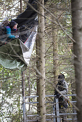 September 28, 2018 - Kerpen, Nordrhein-Westfalen, Germany -A police man tries to talk to tree sitter. Eviction of the occupation of the Hambacher Forest. (Credit Image: © Jannis Grosse/ZUMA Wire)