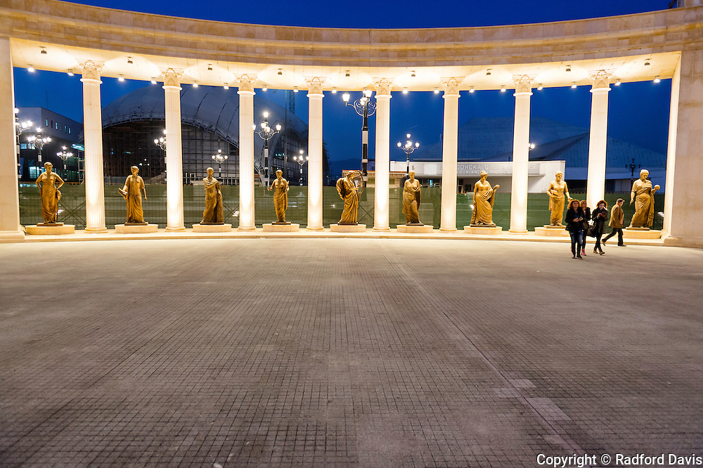 Statures of women musicians are displayed in front of the opera house in Skopje, Macedonia.