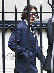 © Licensed to London News Pictures. 07/07/2020. London, UK. US actor Johnny Depp is seen at The High Court in Central London during a break in proceedings. Johnny Depp's libel trial against The Sun newspaper is due to take place over the next three weeks over allegations he was violent and abusive towards his ex-wife Amber Heard. Photo credit: Peter Macdiarmid/LNP
