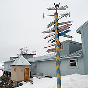Signs pointing to faraway places in front of the Vernadsky Research Base on the Antarctic Peninsula. Originally established by the British first as Base F in the British Falkland Islands Dependencies and later as Faraday Station, it was transferred to the Ukraine in 1996 and renamed Vernadsky Research Base after Soviet mineralogist Vladimir Vernadsky.