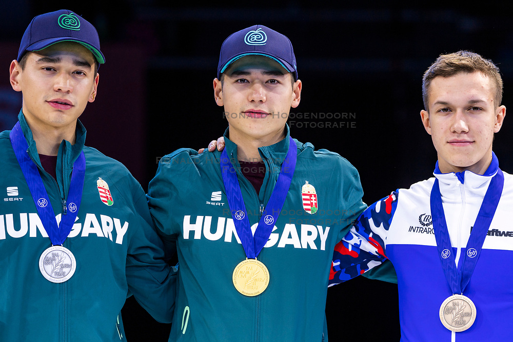 12-01-2019 NED: ISU European Short Track Championships 2019 day 2, Dordrecht<br /> (L-R) Shaolin Sandor Liu and Shaoang Liu of Hungary and Pavel Sitnikov of Russia pose in the Men's 500m medal ceremony during the ISU European Short Track Speed Skating Championships