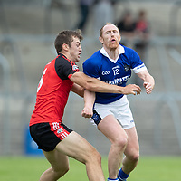 Cratloe's Conor Cooney is tackled by Clondegad's Cillian Brennan