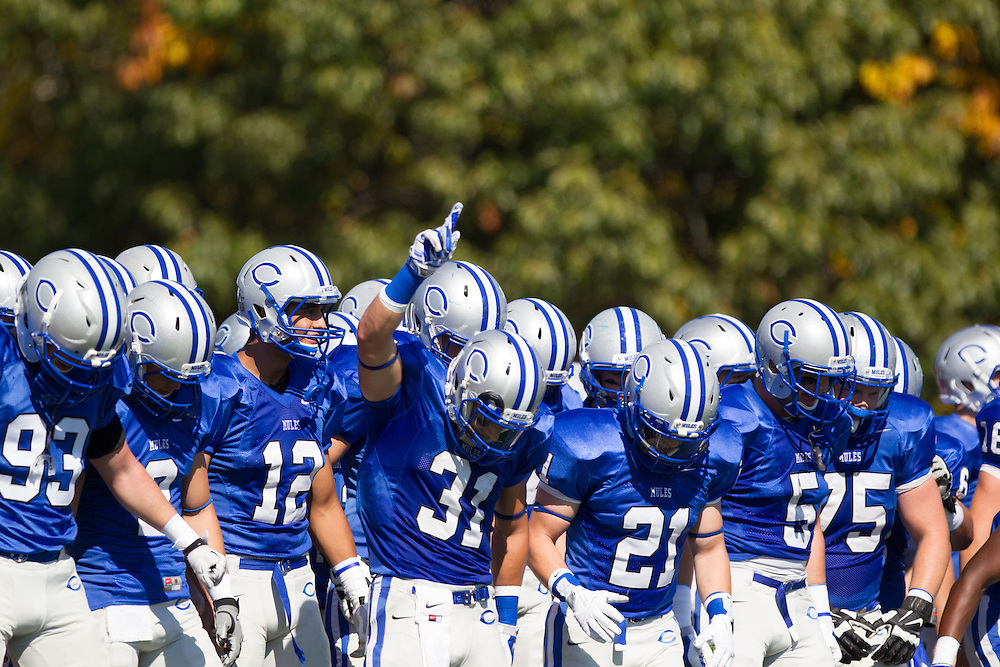 Zach Padula, Ben Zurkow, and Connor Emmert, of Colby College, during a NCAA Division III football game on September 27, 2014 in Waterville, ME. (Dustin Satloff/Colby College Athletics)