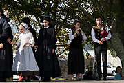 Historical and fictional theatre play acted out on the streets of the town, and with young actors wearing traditional costumes and performing traditional dance to bagpipe music for European heritage days on 18th September 2021 in Pont Croix, Brittany, France. Brittany is a peninsula, historical county, and cultural area in the west of France, covering the western part of what was known as Armorica during the period of Roman occupation. It became an independent kingdom and then a duchy before being united with the Kingdom of France in 1532 as a province governed as a separate nation under the crown.