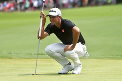 August 12, 2018 - St. Louis, Missouri, U.S. - ST. LOUIS, MO - AUGUST 12: Adam Scott lines up his putt on the #1 green during the final round of the PGA Championship on August 12, 2018, at Bellerive Country Club, St. Louis, MO.  (Photo by Keith Gillett/Icon Sportswire) (Credit Image: © Keith Gillett/Icon SMI via ZUMA Press)