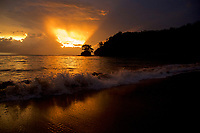 sunset with amazing beams of light over Coiba National Park, viewed from Pixvae Village, Panama