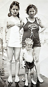 damaged vintage picture of mother with adult daughter and a little boy