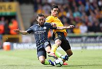 Football - 2018 / 2019 Premier League - Wolverhampton Wanderers vs. Manchester City<br /> <br /> Raul Jimenez of Wolverhampton Wanderers and Bernardo Silva of Manchester City at Molineux.<br /> <br /> COLORSPORT/LYNNE CAMERON