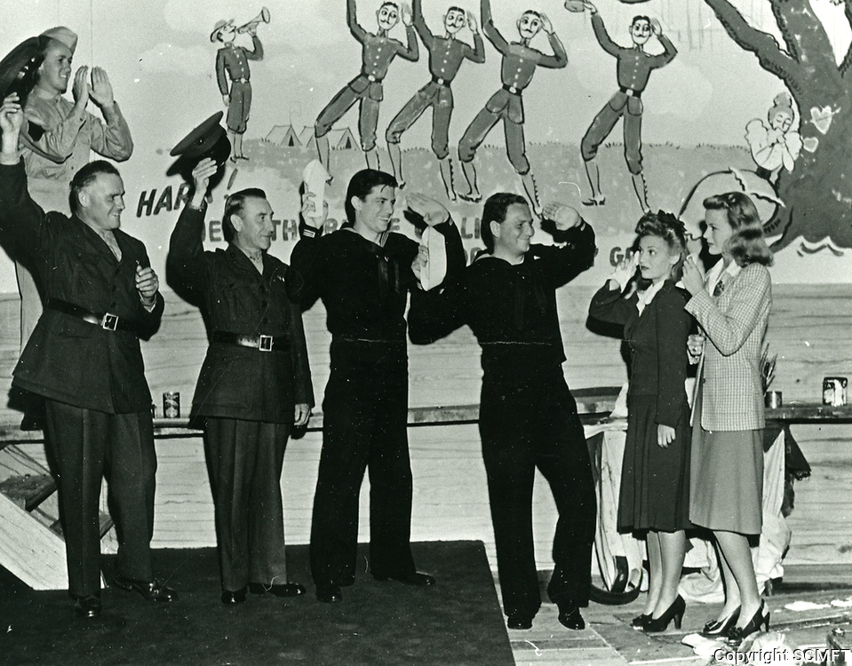 1943 Actress, K.T. Stevens (at right) with visiting servicemen with the Hollywood Canteen